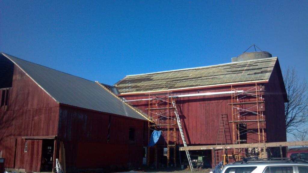 Half way through repairing the barn roof.